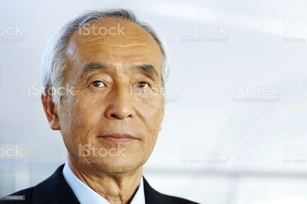 Closeup portrait of senior Japanese  businessman royalty-free stock photo