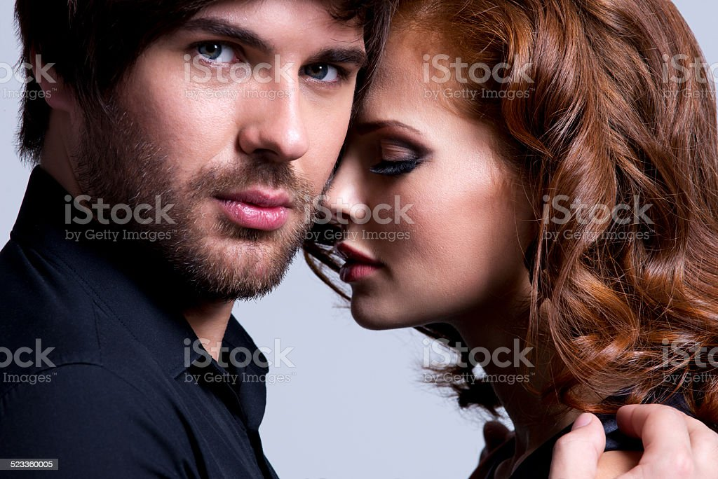 Closeup portrait of sexy couple in love. stock photo