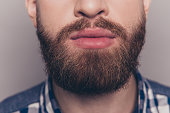 closeup portrait of stylish young man with heavy beard
