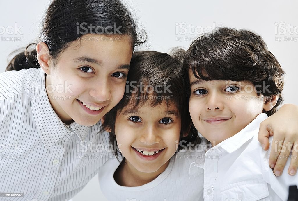 Close-up portrait of three young children stock photo