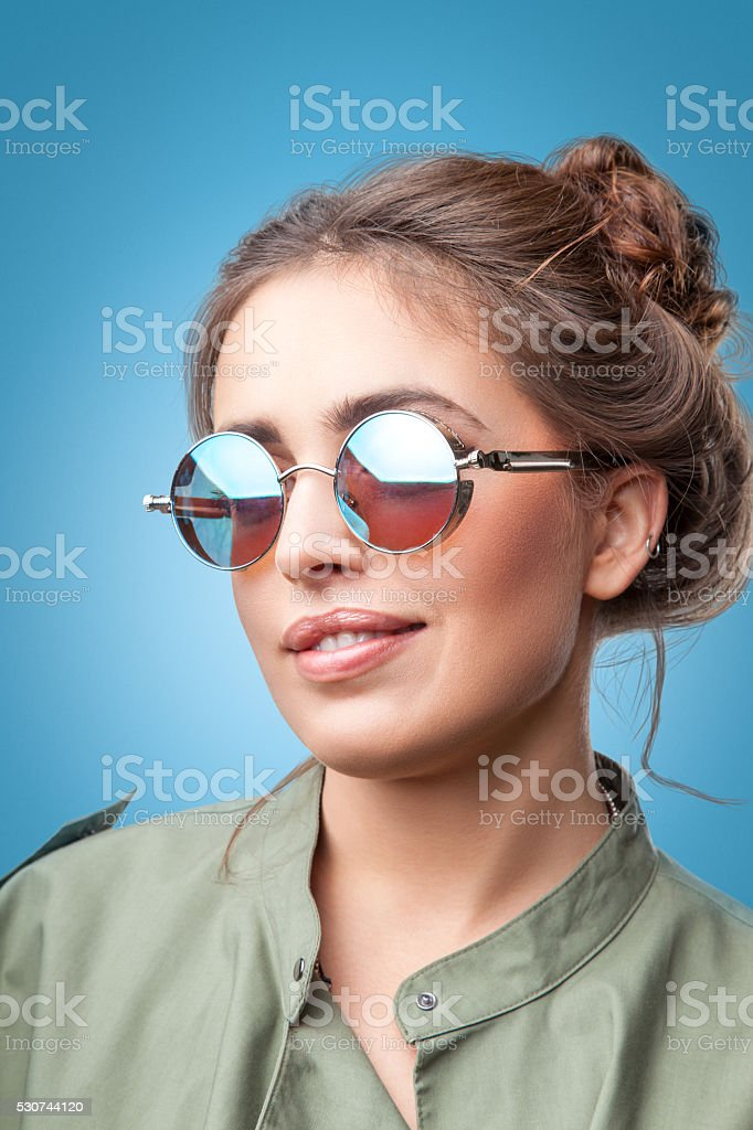 Closeup portrait of trendy hipster girl  with hair buns smiling stock photo