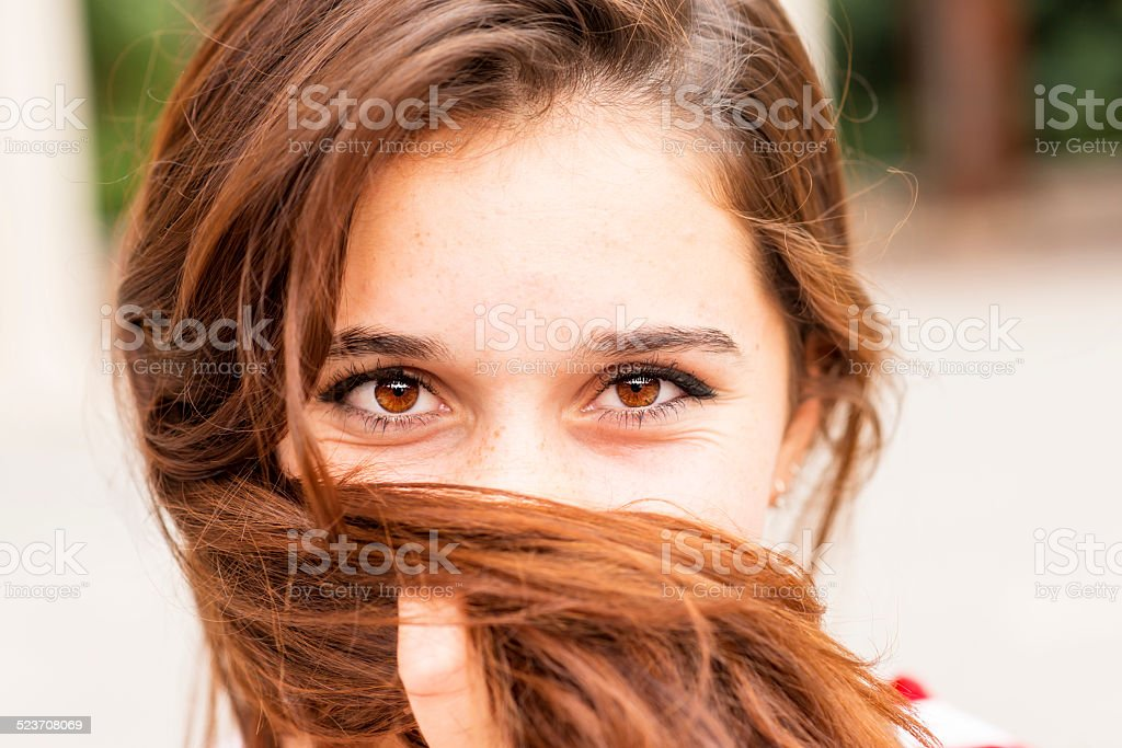 Closeup portrait of woman covers her face of hair. stock photo