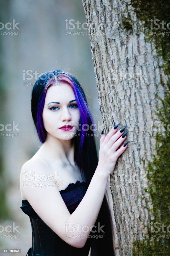 Close-up portrait of woman in gothic style stock photo