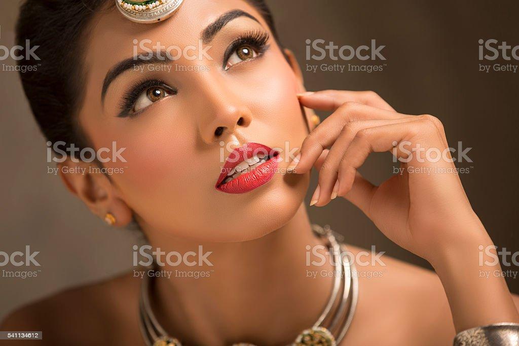 closeup portrait of women looking above . stock photo