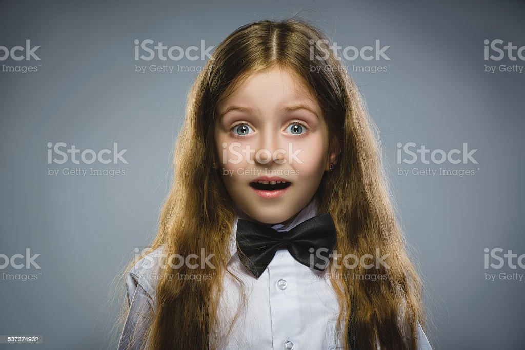 Closeup Portrait of wondering girl going surprise on gray background stock photo