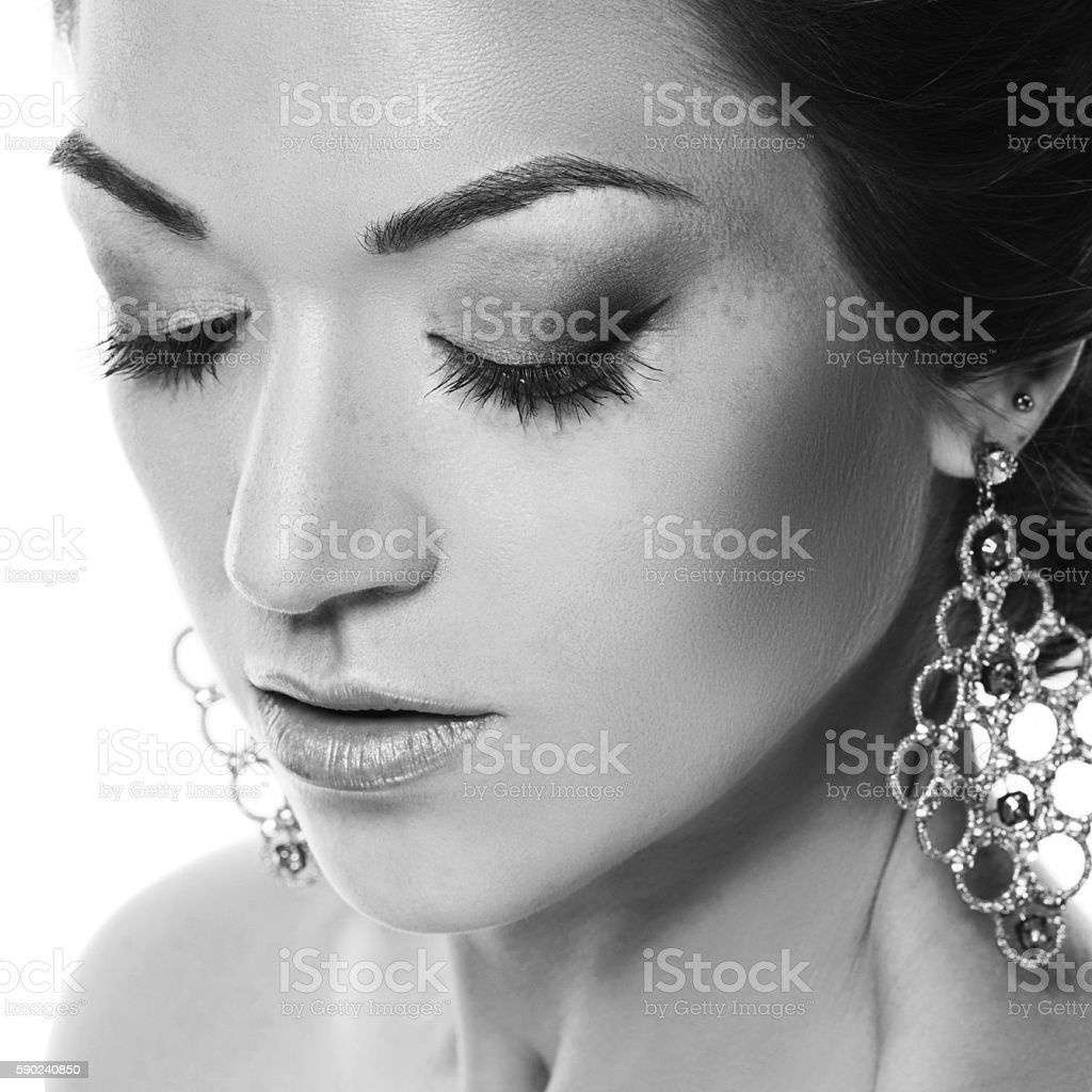 Close-up portrait of young closing eyes woman's face stock photo