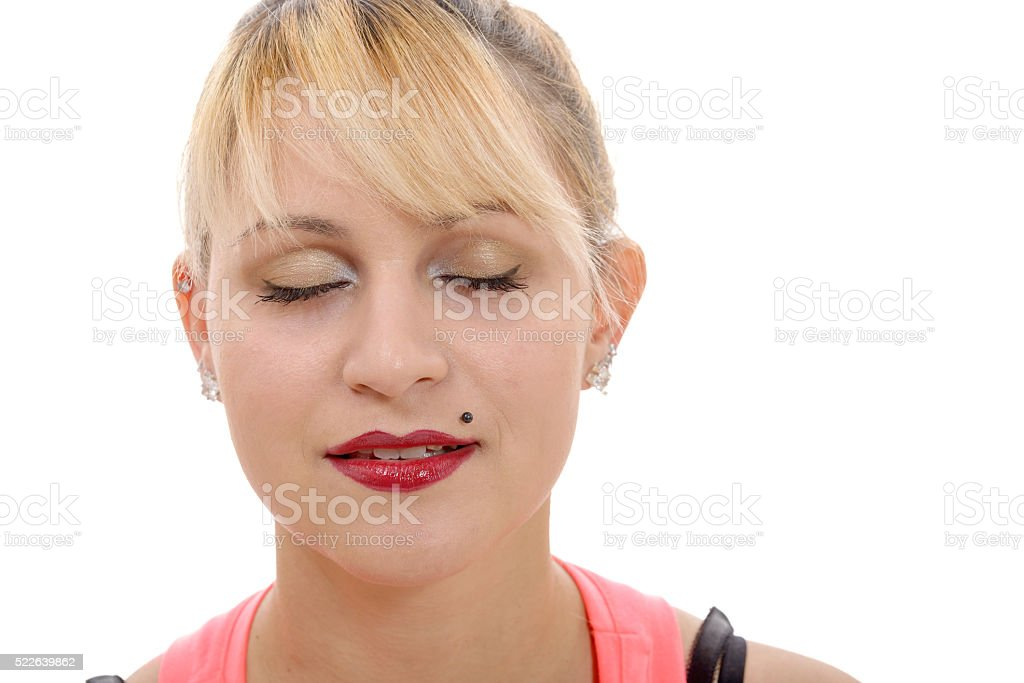 Close-up portrait of young closing eyes woman's stock photo