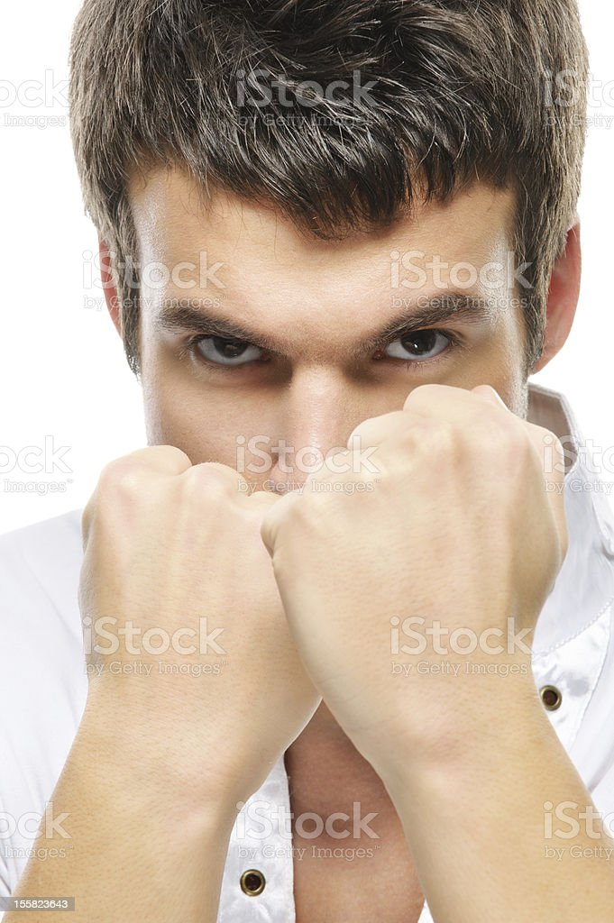 close-up portrait of young man holding fists royalty-free stock photo