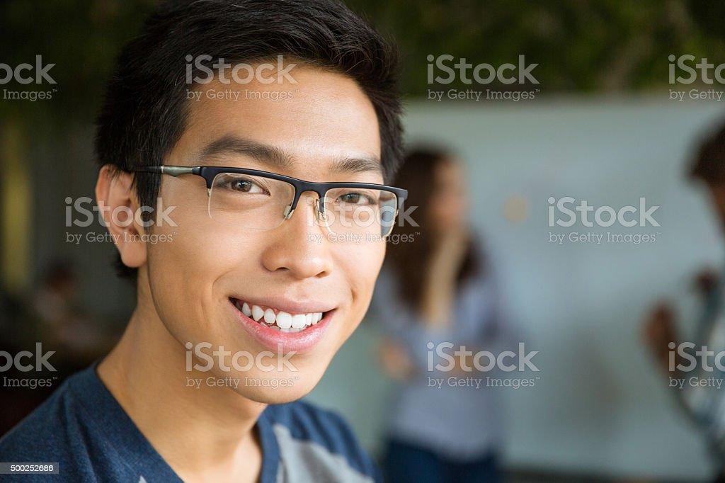 Closeup portrait of young positive asian man stock photo
