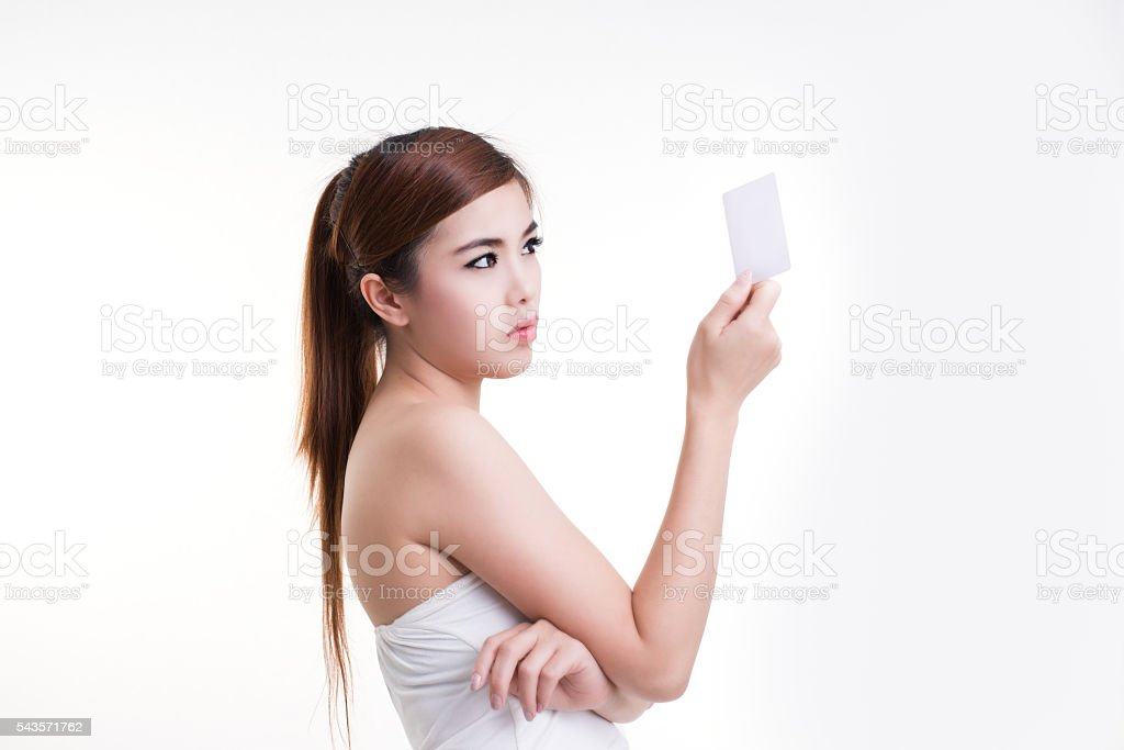 Close-up portrait of young woman holding credit cardใ stock photo