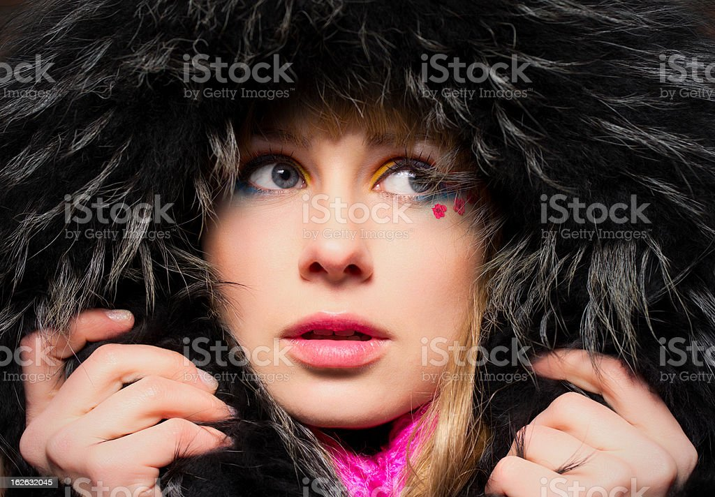 Closeup portrait of young woman in hood royalty-free stock photo