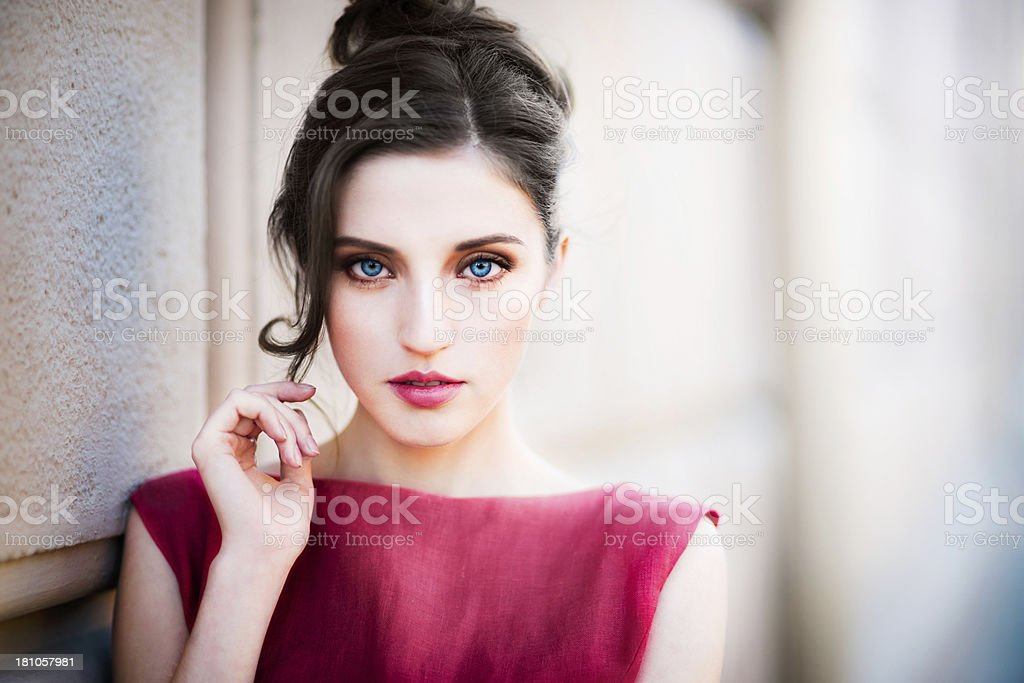 Close-up portrait of young woman in red dress stock photo