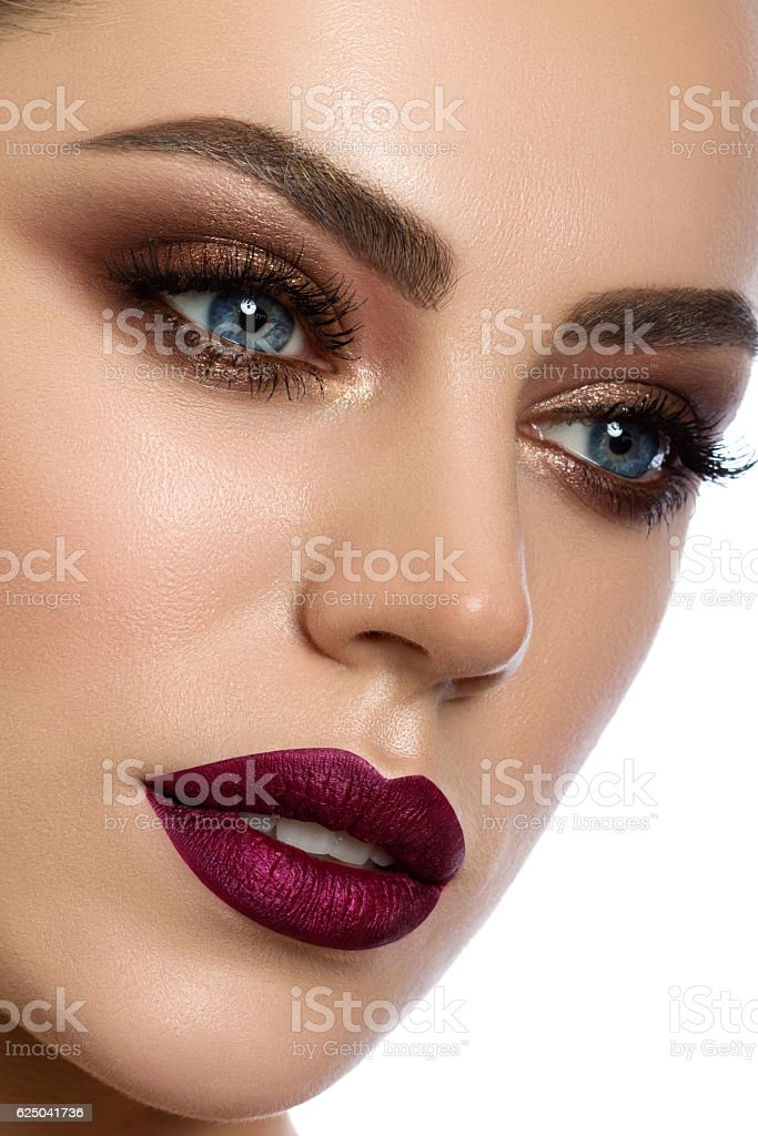 Close-up portrait of young woman with modern make up stock photo