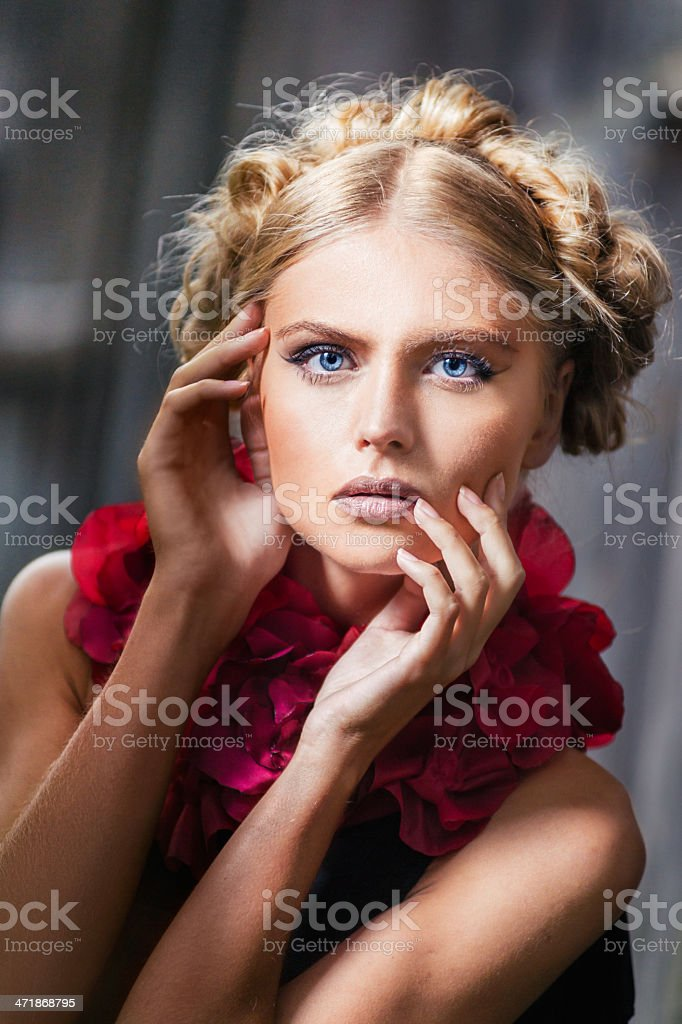 Close-up portrait of young woman with red bolero royalty-free stock photo