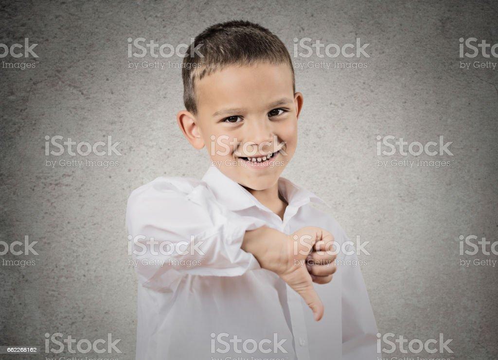 Closeup portrait sarcastic young man showing thumb down stock photo