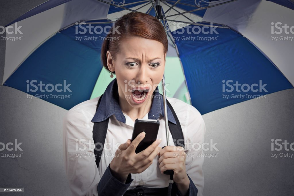 Closeup portrait shocked surprised business woman corporate executive reading bad breaking news stock photo