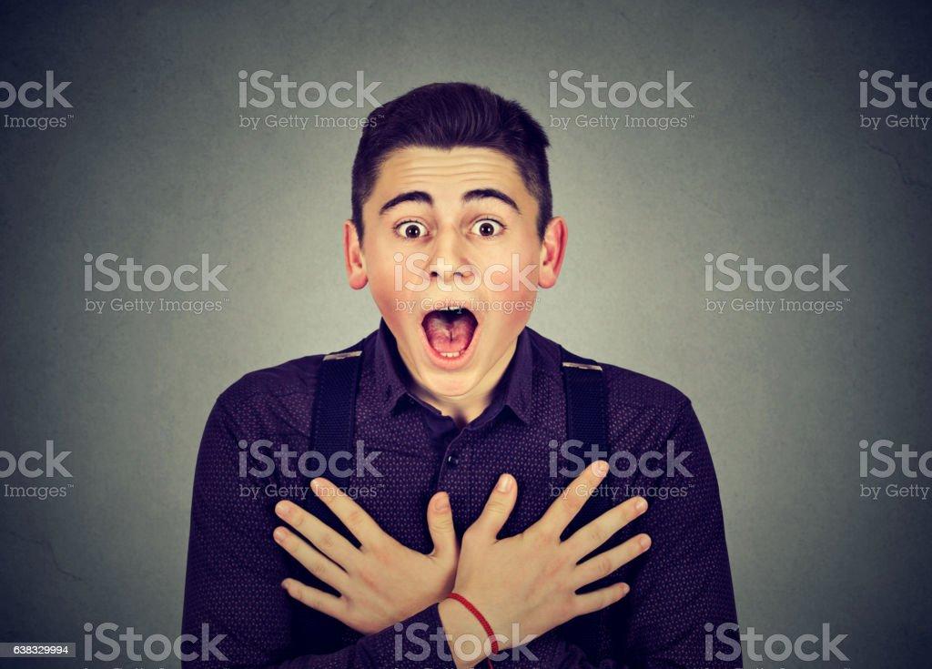 Closeup portrait shocked young man stock photo