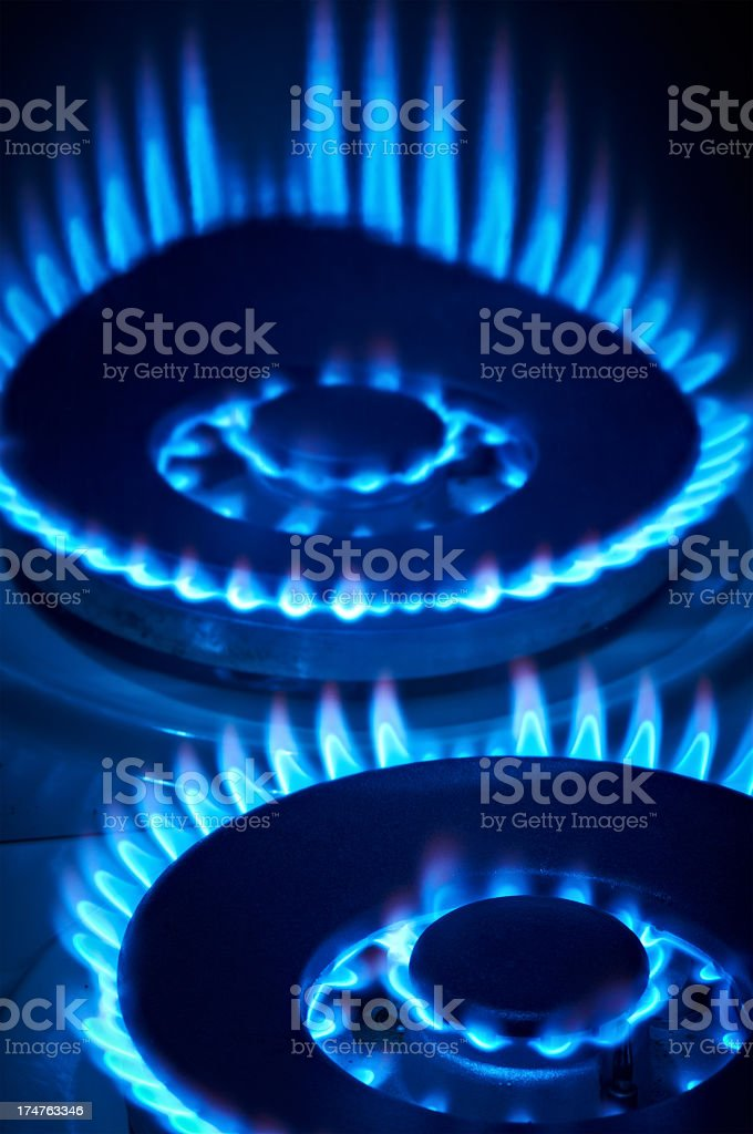 Close-up portrait shot of flames from a gas stove royalty-free stock photo