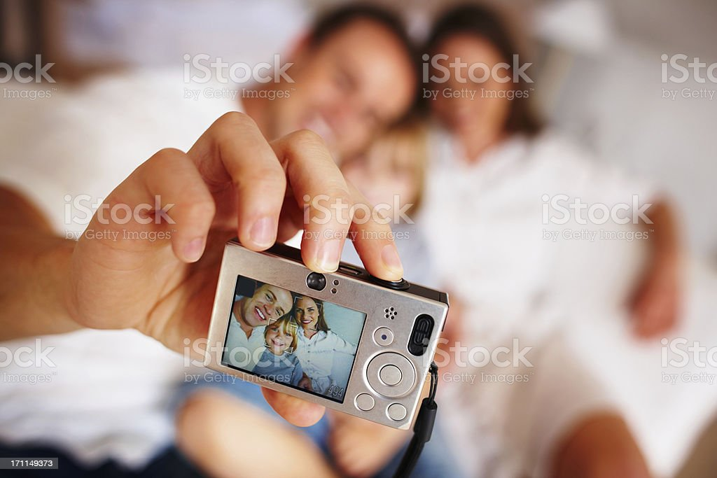 Closeup portrait showing father taking photo of a whole family royalty-free stock photo