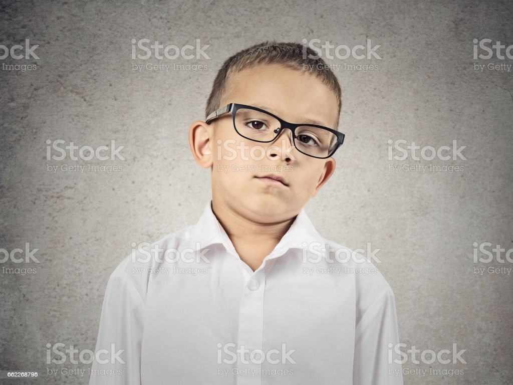Closeup portrait skeptical boy with glasses stock photo