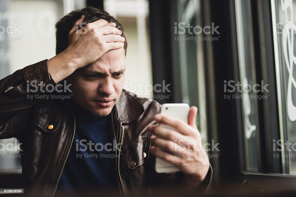 Closeup portrait, stressed young man in purple sweater, shocked surprised stock photo