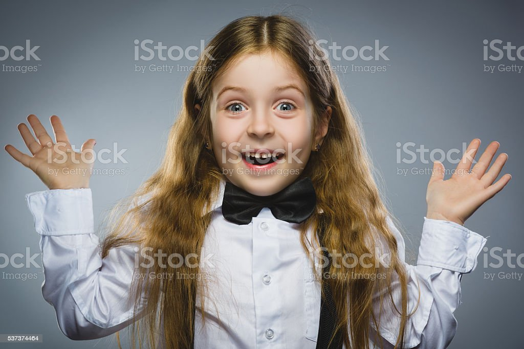 Closeup portrait successful happy girl going surprise isolated on gray stock photo