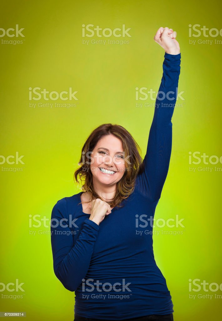 Closeup portrait winning successful young business woman happy ecstatic celebrating being winner stock photo
