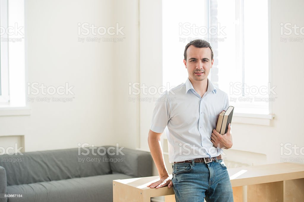 Closeup portrait, young business man or teacher in blue shirt stock photo