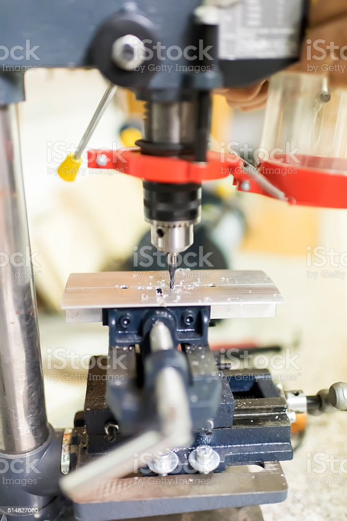 Close-up process of metal machining by mill stock photo