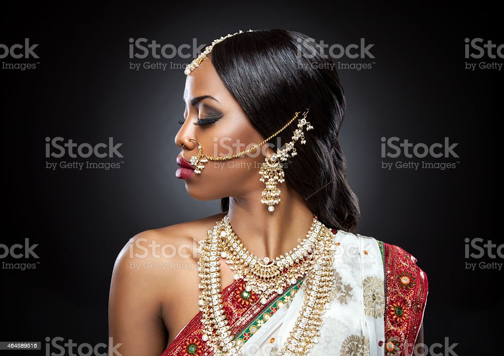 Close-up profile of an Indian bride in full finery stock photo