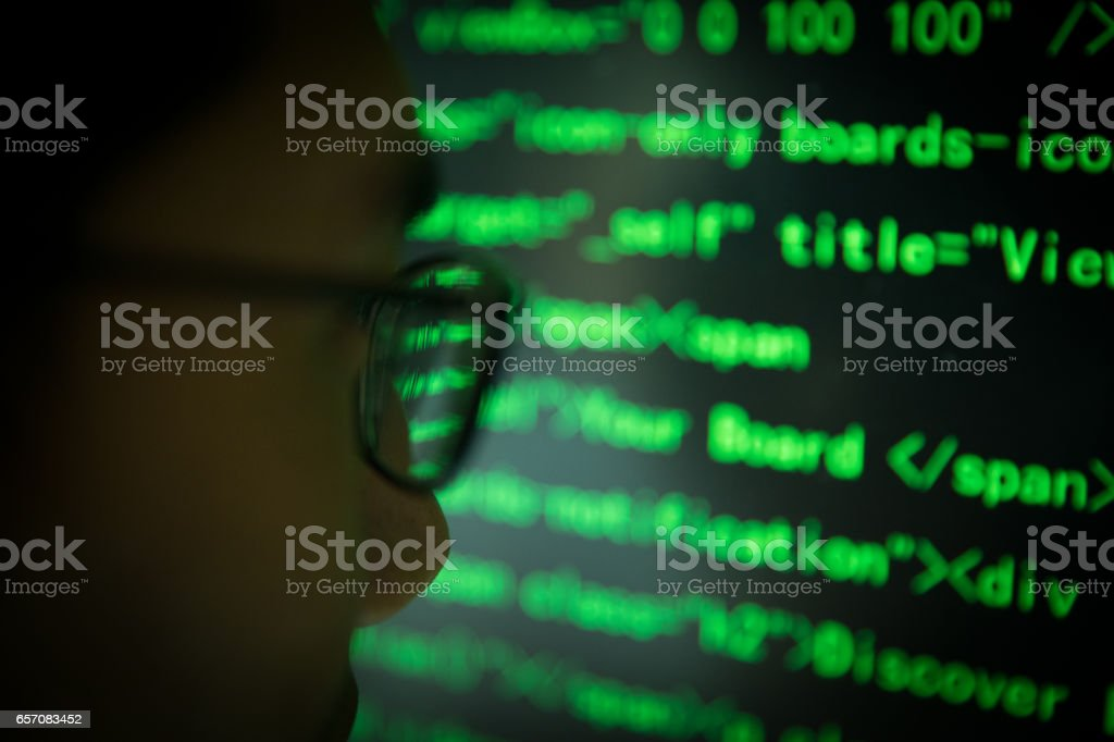 Close-up programmer working with computer stock photo