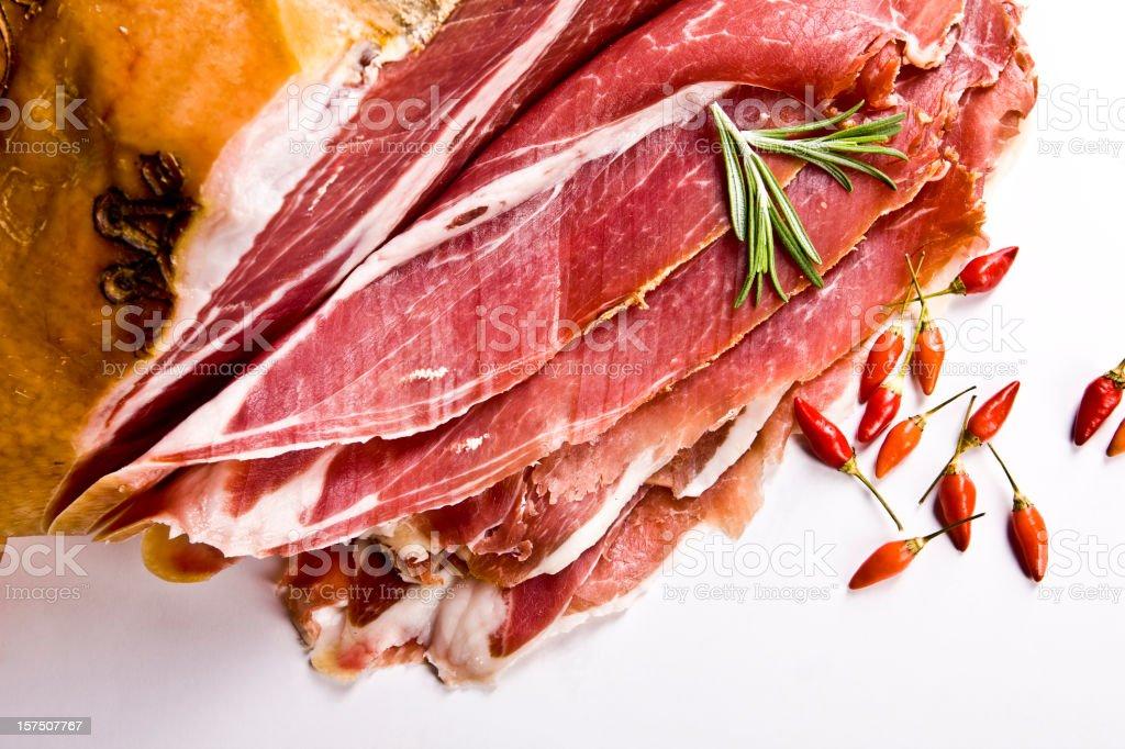 Closeup Prosciutto (Italian Ham) with Red Pepperony royalty-free stock photo