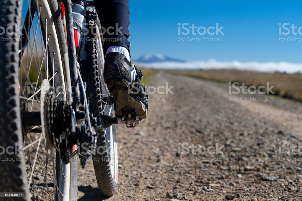 Close-up rear-view of a bicycle on Gavel Road, New Zealand stock photo