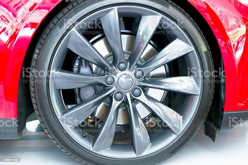 Closeup red car alloy wheel with carbon ceramic brake stock photo