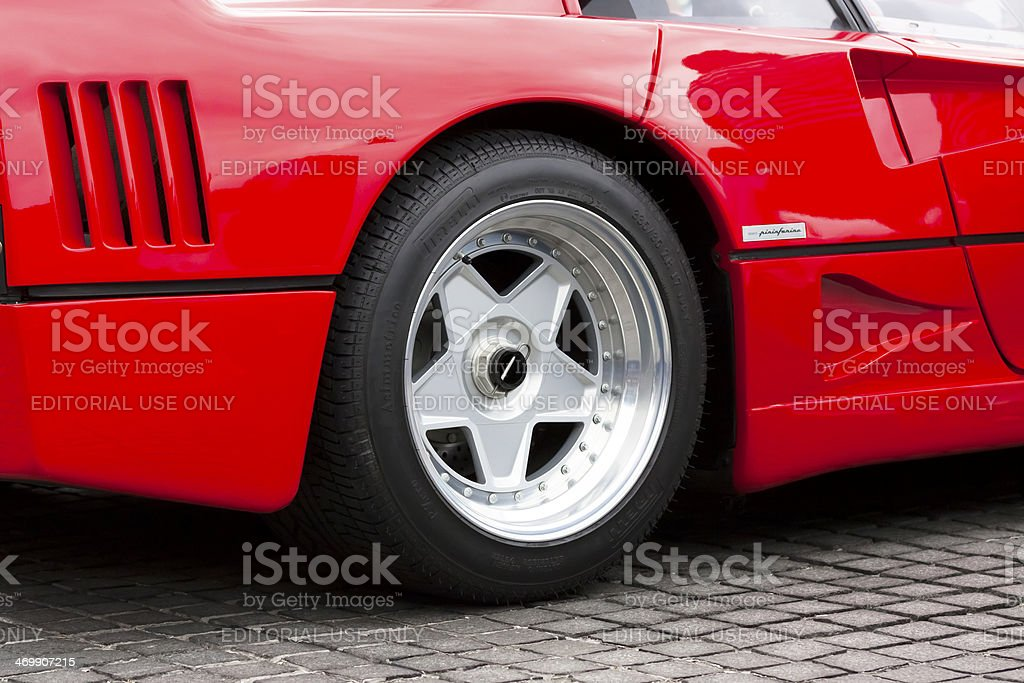 Closeup red Ferrari F40 alloy wheel stock photo