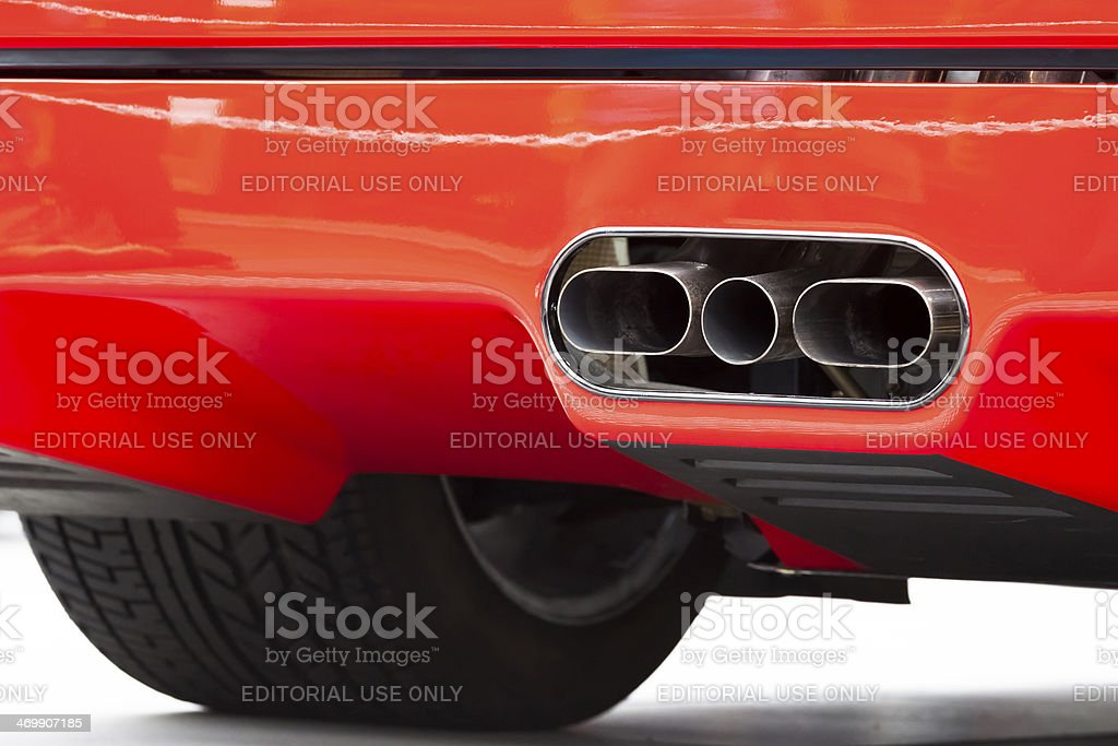 Closeup red Ferrari F40 exaust pipes, copy space stock photo