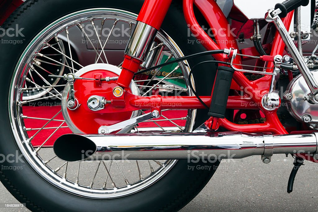 Closeup red motorbike rear wheel and exhoust pipe stock photo
