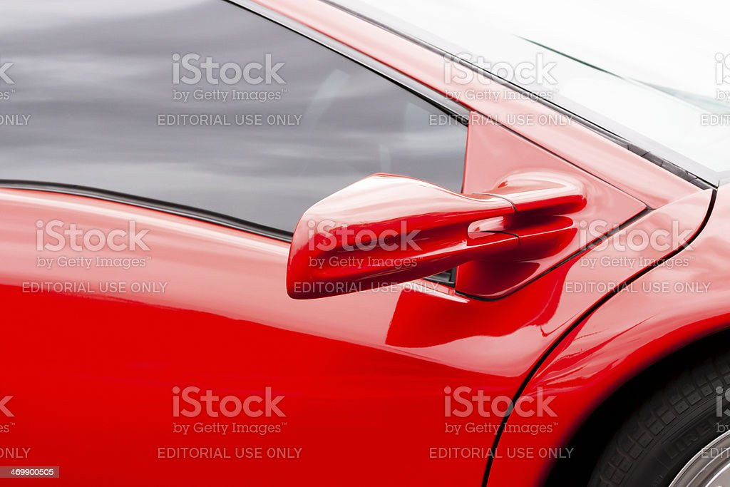 Closeup reversing mirror of red Lamborghini, copy space stock photo