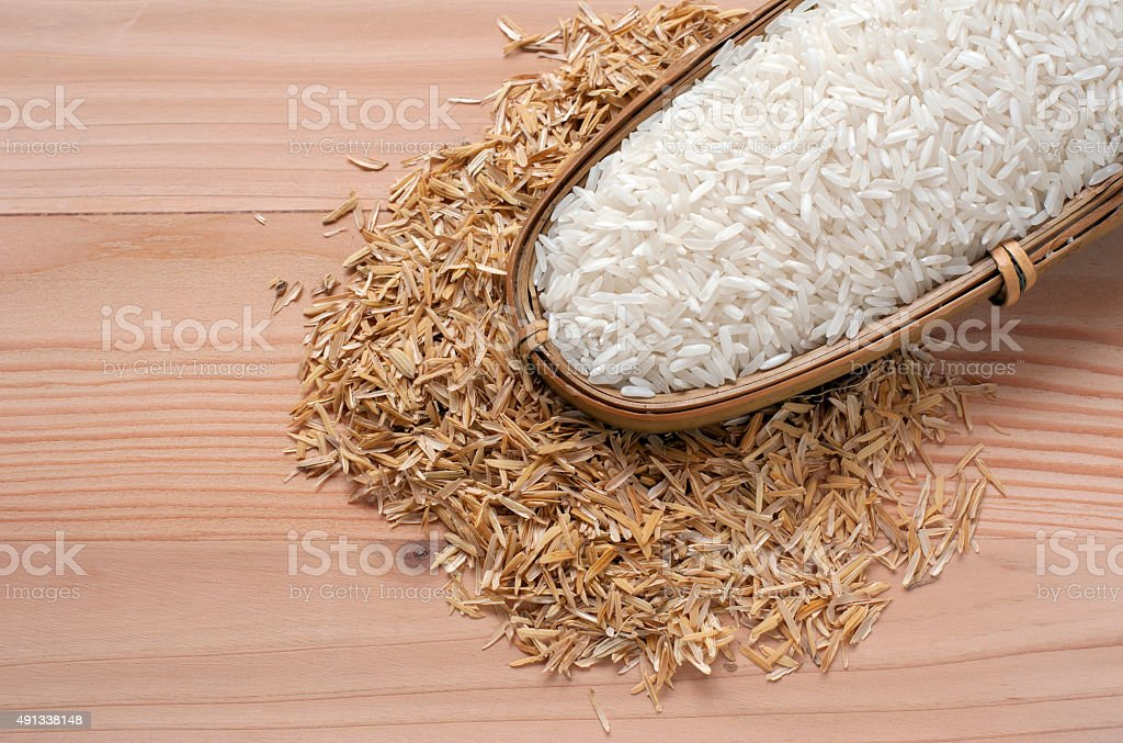 close-up rice and rice hulls  on the wooden background stock photo