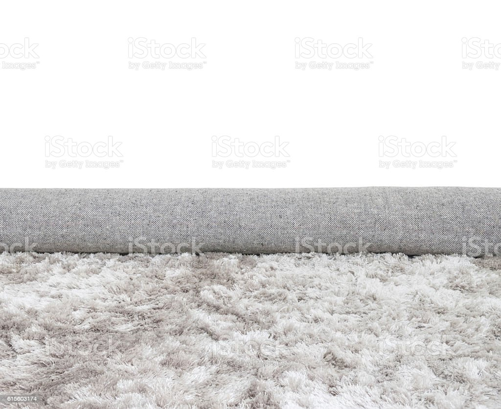 Closeup roll gray fabric carpet isolated on white background stock photo