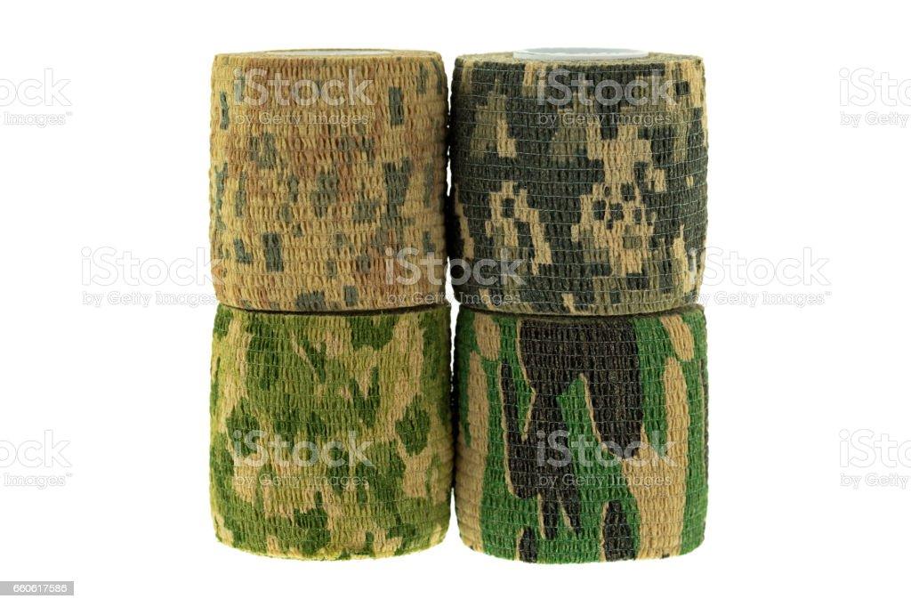 Closeup rolls of fabric camouflage pattern stretchable bandage tape isolated on white background stock photo