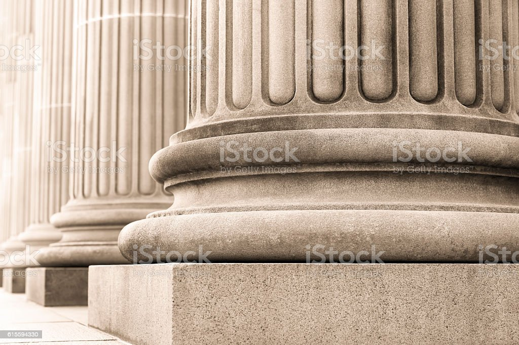 Closeup row of capital columns, background with copy space stock photo