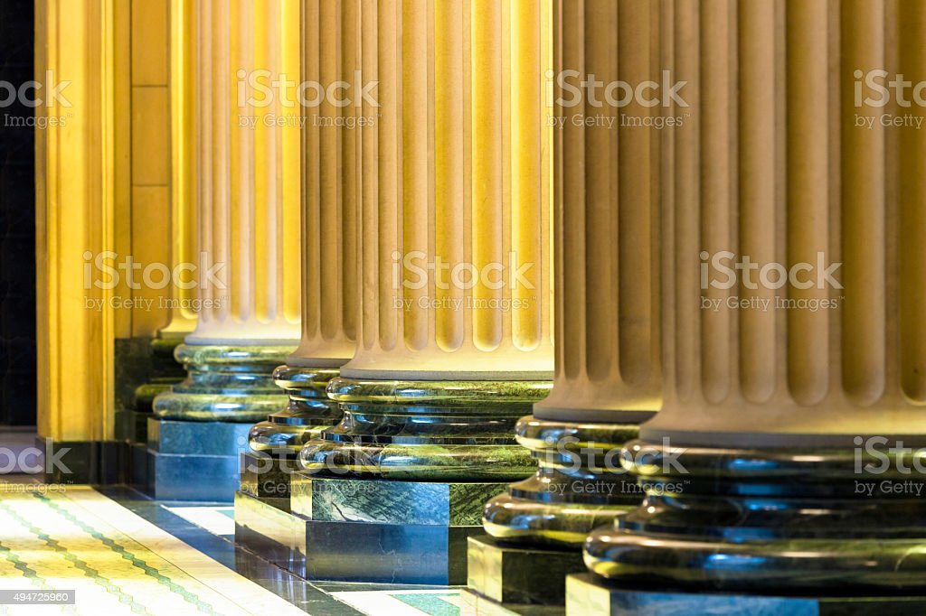 Closeup row of classical marble columns indoor stock photo