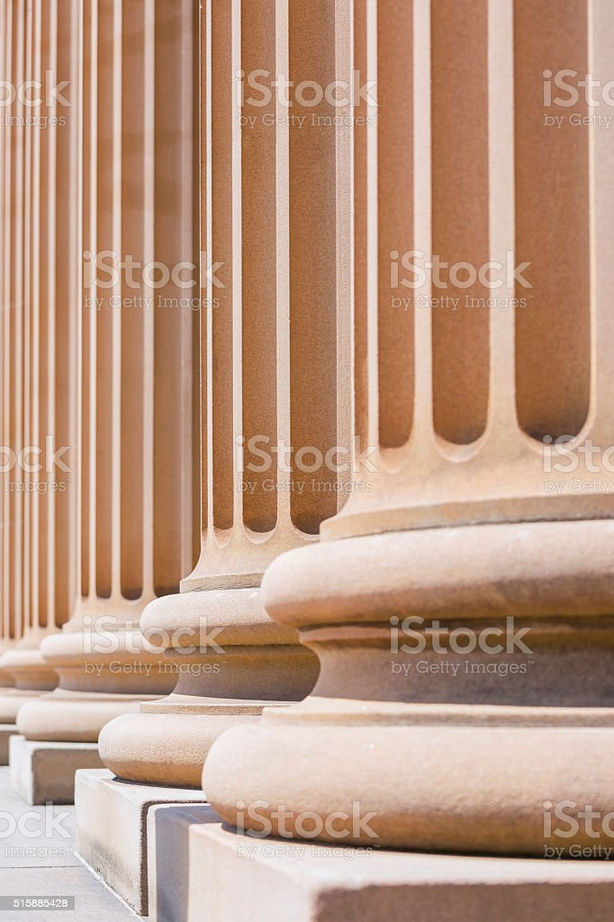 Closeup row of classical stone columns, copy space stock photo