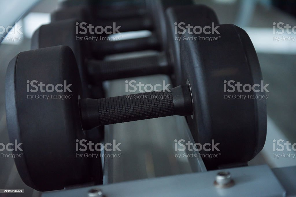 Closeup Rows of dumbbells in the gym stock photo