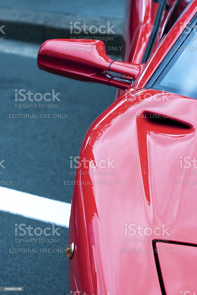 Closeup rrear view of reversing mirror of red Lamborghini stock photo