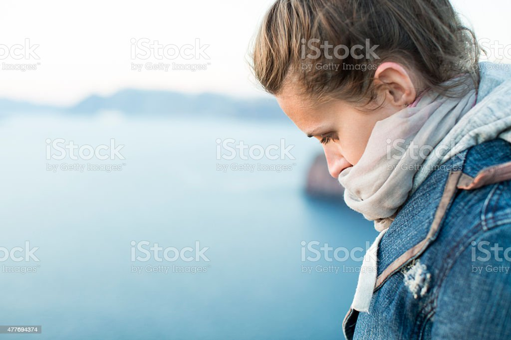 Close-up sad depressed woman thought outdoors. stock photo