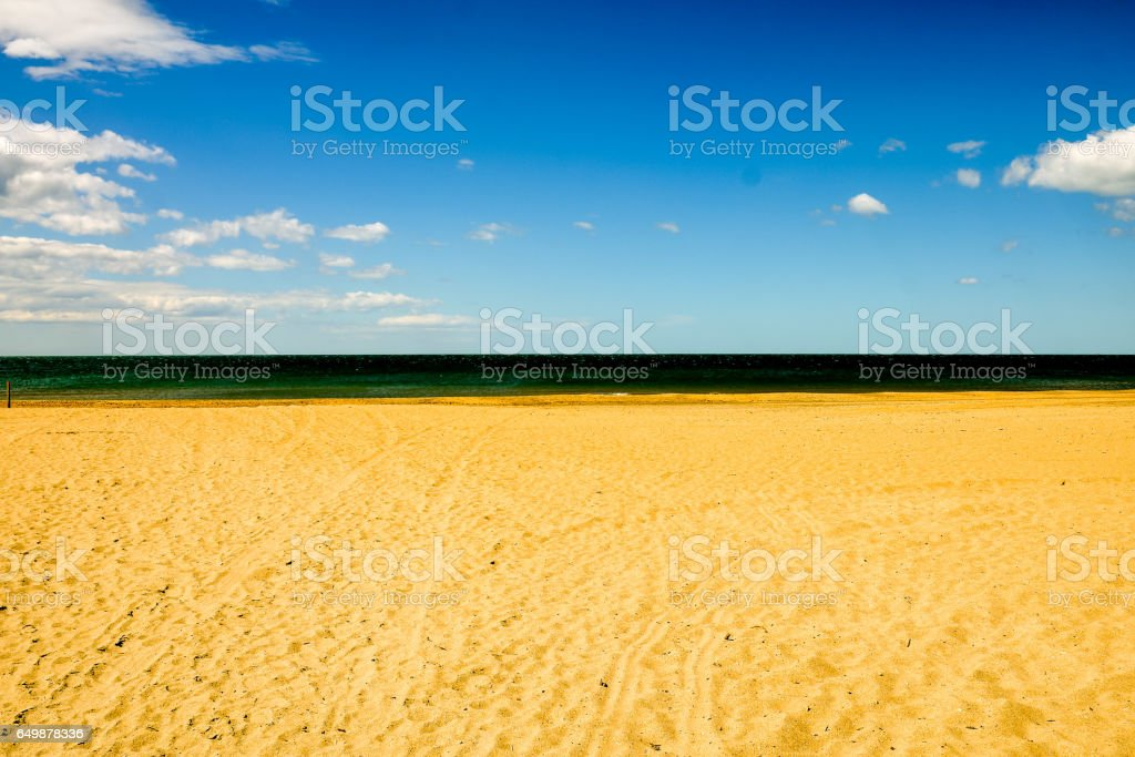 closeup sand pattern of a beach in the summer stock photo