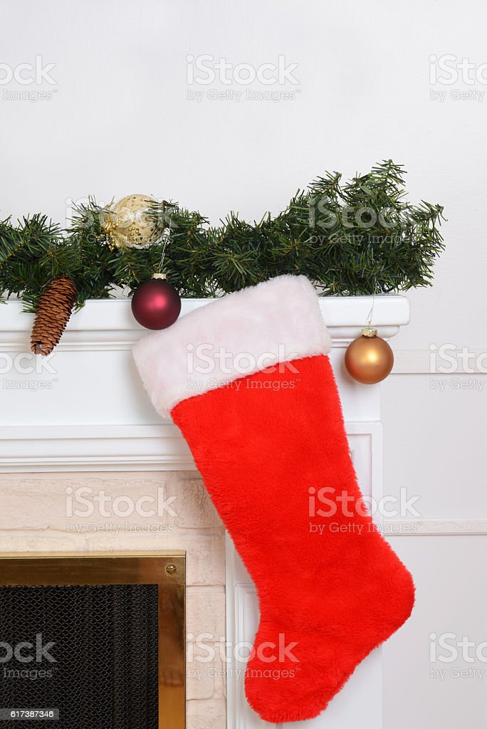 closeup santa sock on fireplace stock photo