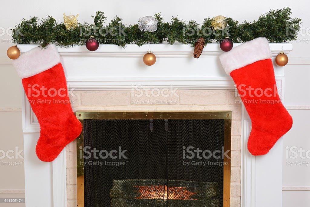 closeup santa stockings on fireplace stock photo